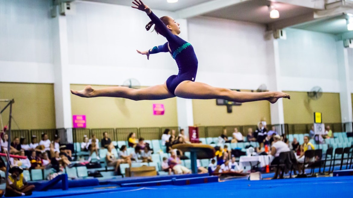 Girl performing artistic gymnastics